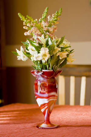 Bouquet of flowers in an antique glass vase. Stock Photo