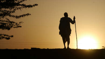 GWALIOR, INDIA - APRIL 12, 2016: An unidentified indian old man standing in evening time. Silhouette shot. Editorial