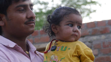 GWALIOR, INDIA - APRIL 14, 2016: An unidentified indian man with his child.