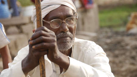 GWALIOR, INDIA - APRIL 16, 2016: Close up of an unidentified indian old man sitting and thinking.