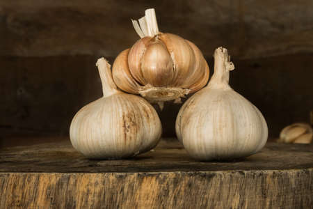garlics: garlics on wooden cutting board. Stock Photo