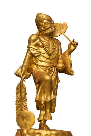 vintage ancient golden god of fortune statue.god of chinese people. Stock Photo