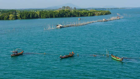 three fishing boat on the sea photo