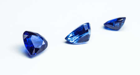 three blue sapphires with white background photo