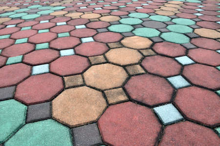Brick pathway colorful in the park photo