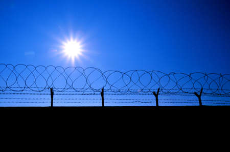 anti terrorist: Fence with a barbed wire