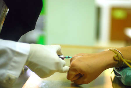 Young Woman Having Blood Test  photo