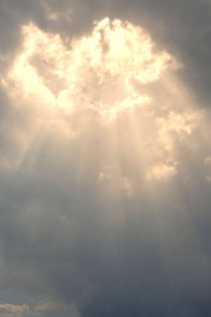 Bright God-rays and light burst in Heavenly Clouds photo