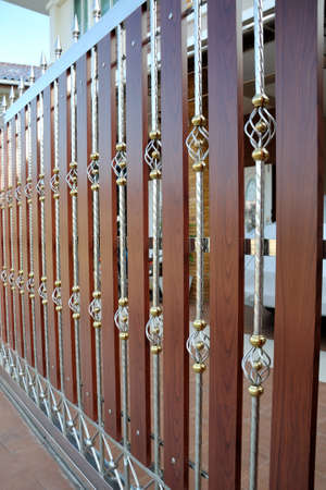 iron bars: A Picture Of Metal and Wood Fence
