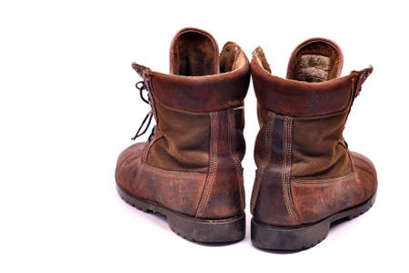 steel toe boots: A pair of well worn Work Boots.
