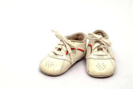 Baby first sports shoes on white background Stock Photo - 12978737