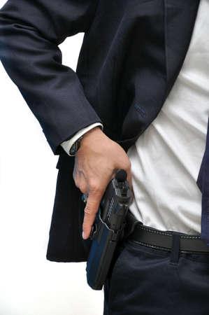 pistolas: Agente llevaba arma blanca camisa dibujo de la funda Foto de archivo