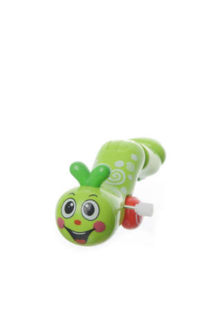 to creep:  a green worm on a white background