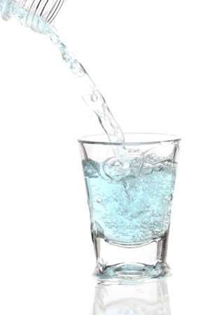 Glass of cold water with splash and blebs photo