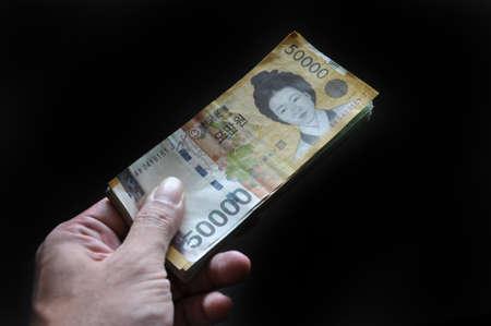 Closeup of South Korea money - 50 thousand Won banknotes on black background