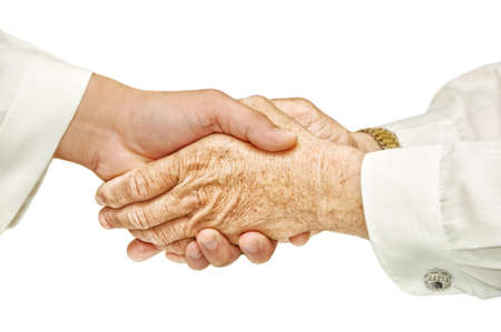 Hand shake - hand shake in front of a white background Stock Photo