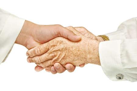 Hand shake - hand shake in front of a white background 版權商用圖片