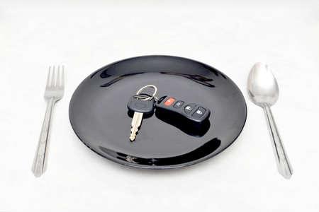car key on black dish Ready to serve