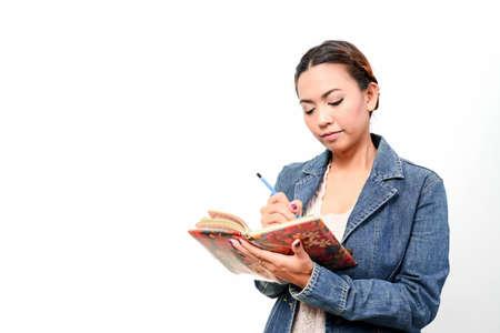 working women write in a book Stock Photo - 22219771