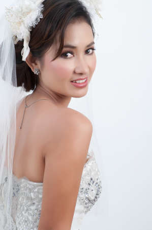 Young bride looking with wedding dress. photo