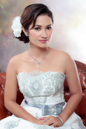 sidewards: Young bride looking with wedding dress.