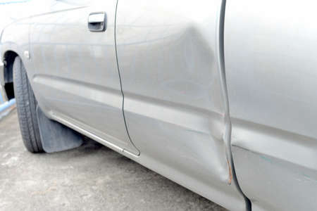 dent: Car with dent on left side   Stock Photo