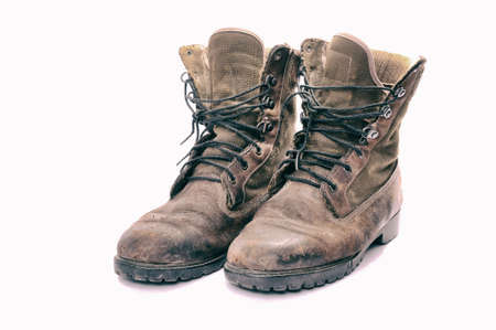 foot ware: A pair of well worn Work Boots.