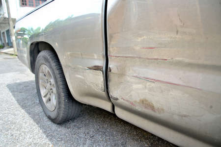 dent: Car with dent on left side .