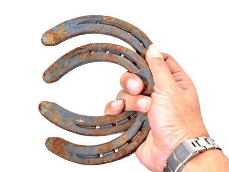 iron horse: old rusty horseshoe isolated on white background.