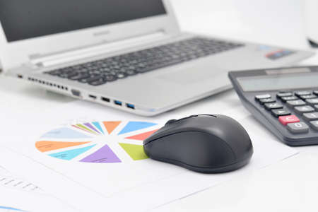 financial controller: Mouse computer and Financial graphs Stock Photo