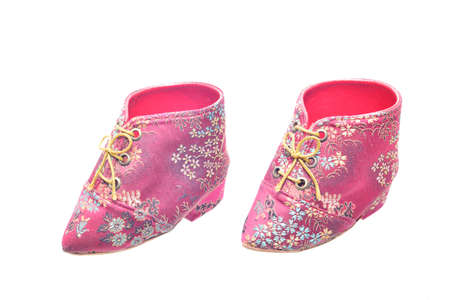bound woman: Miniature antique chinese womans shoes worn by an old woman with bound feet Stock Photo