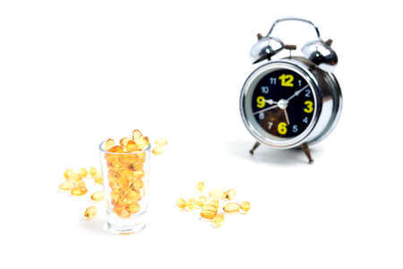 memory drugs: Medicine in glass with alarm clock. Stock Photo