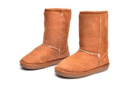 sheepskin: Sheepskin boots isolated on white