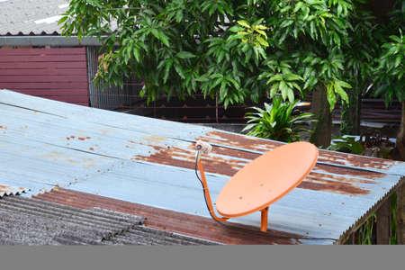 parabolic mirror: Satellite dish on roof Stock Photo