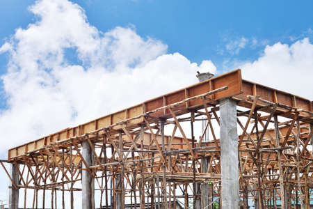 Construction site with scaffolding against blue clear sky Stock Photo