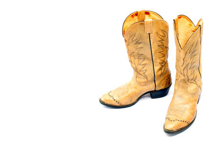 Cowboy boot isolated on white background , Western cowboy boots. , Natural leather cowboy boots. Stock Photo