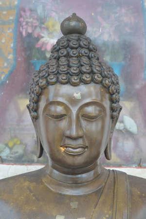 Focus on the Buddhas head. Stock Photo