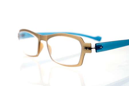 shortsightedness: old eyes glasses on white background
