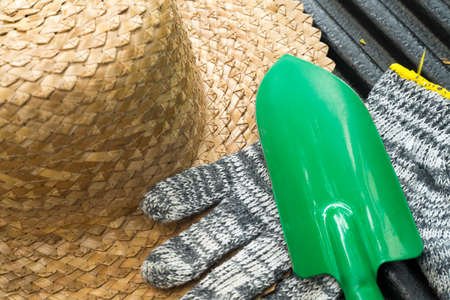 Image of gardening hat with shovel and gloves
