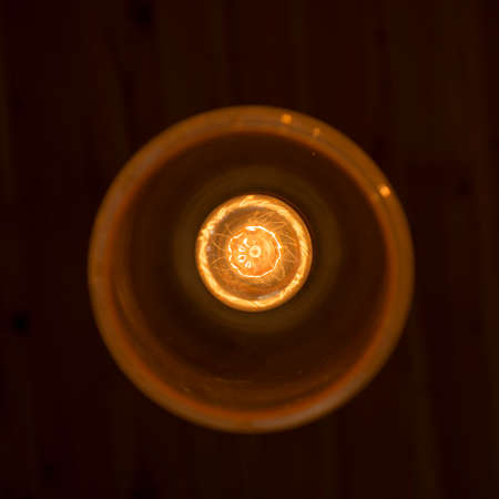 filament: Light bulb illuminated and taken from above