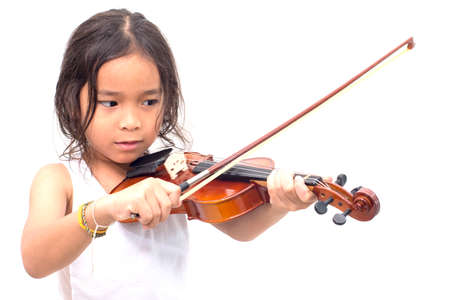 niños actuando: Asian boy playing violin in undershirt isolated on white background Foto de archivo