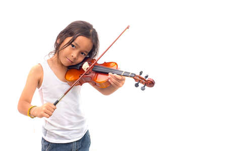 Asian boy playing violin in undershirt isolated on white background Reklamní fotografie