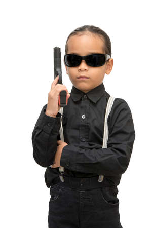 young asia boy with gun isolate on white background. Stock Photo