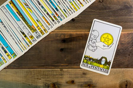 ACE of PENTACLES tarot cards on the table.