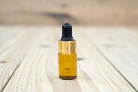 Bottle serum for beauty treatment on wooden background.