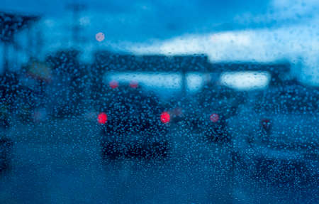 drive through: Rain drops on the windshield in rainy days