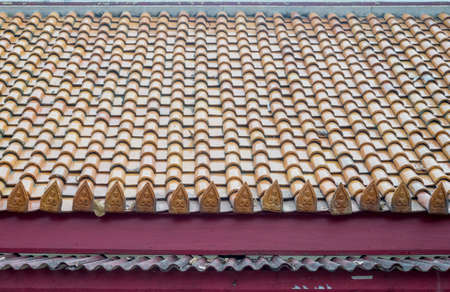 Pattern detail of old ceramic roof tiles of Buddhist temple.