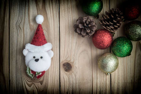 christmas decoration with bear in red santa cap retro style toned
