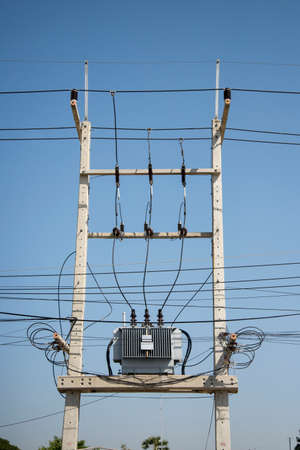 Transformer substation of high voltage on blue sky Stock Photo