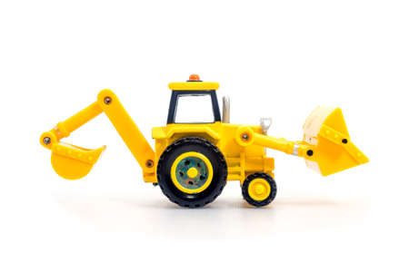 Tractor with backhoe and loader toy isolated on white bacground . Childrens Developmental, creative thinking toy car. Stock Photo